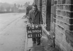 SD990678K2, Man marking Ordnance Survey minor control revision point with an arrow in 1950s