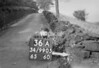SD990536A, Man marking Ordnance Survey minor control revision point with an arrow in 1950s