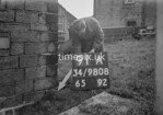 SD980891A, Man marking Ordnance Survey minor control revision point with an arrow in 1950s
