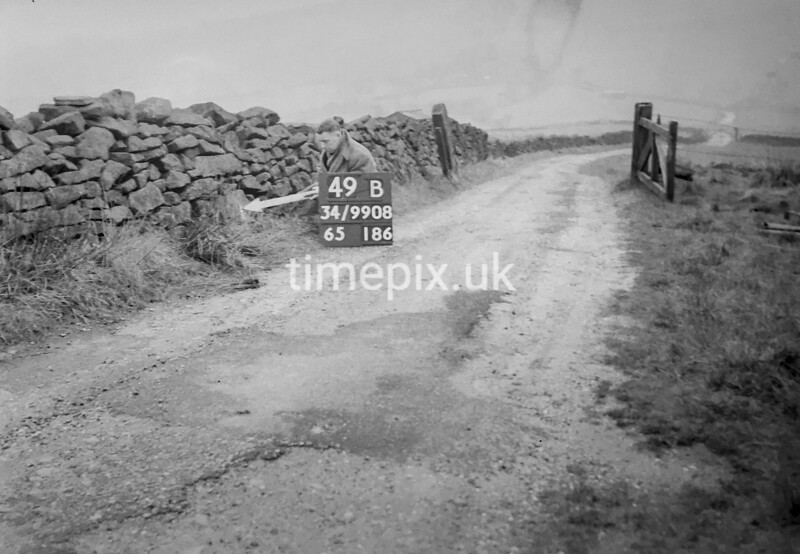 SD990849B, Man marking Ordnance Survey minor control revision point with an arrow in 1950s