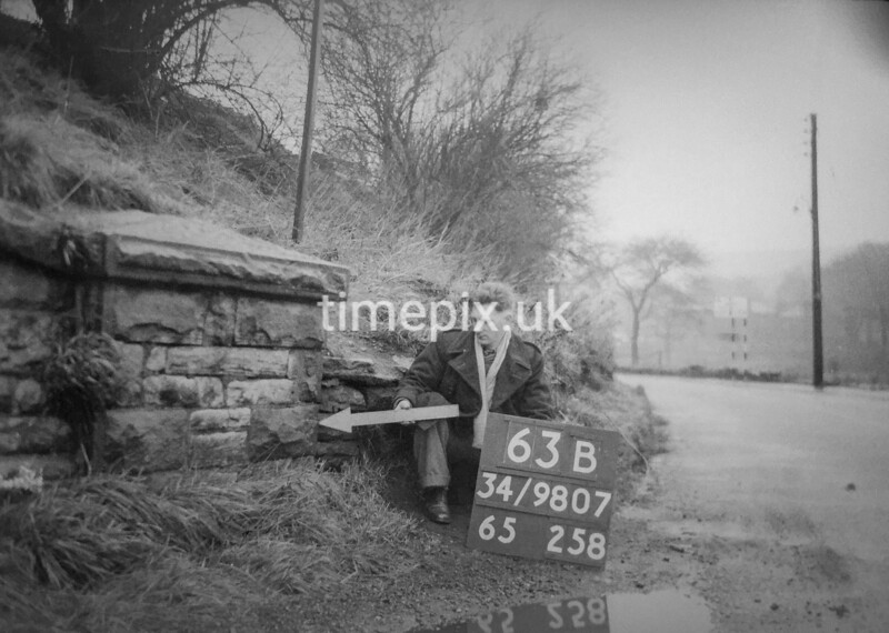 SD980763B, Man marking Ordnance Survey minor control revision point with an arrow in 1950s