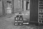 SD990587A, Man marking Ordnance Survey minor control revision point with an arrow in 1950s