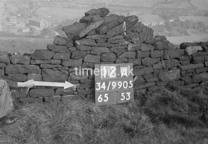 SD990512A, Man marking Ordnance Survey minor control revision point with an arrow in 1950s