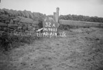 SD980532A, Man marking Ordnance Survey minor control revision point with an arrow in 1950s