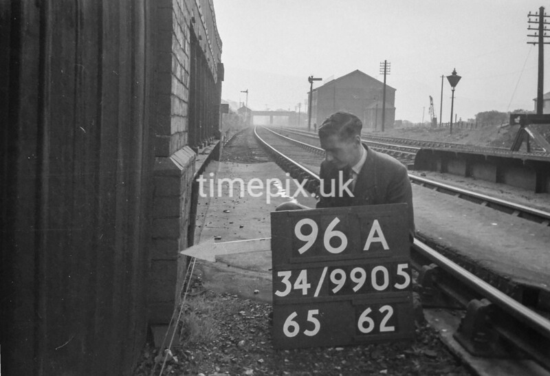 SD990596A1, Man marking Ordnance Survey minor control revision point with an arrow in 1950s