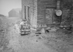 SD980970L, Man marking Ordnance Survey minor control revision point with an arrow in 1950s