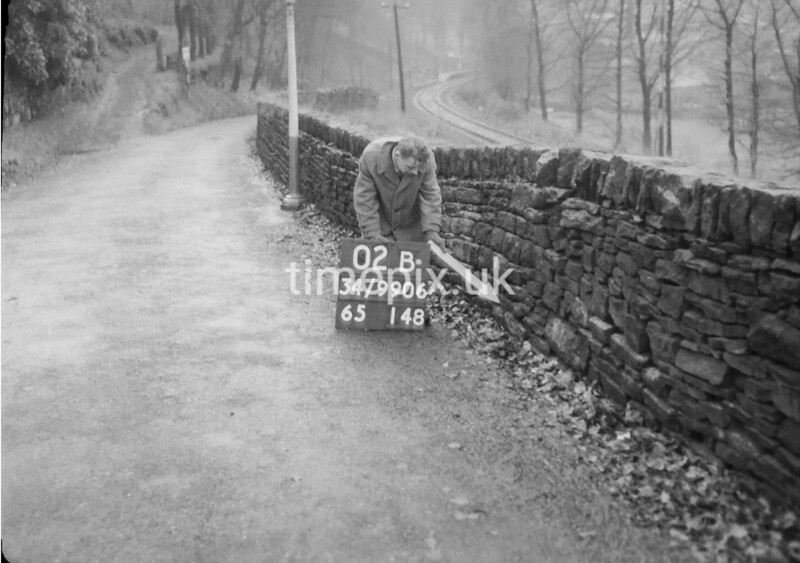 SD990602B2, Man marking Ordnance Survey minor control revision point with an arrow in 1950s