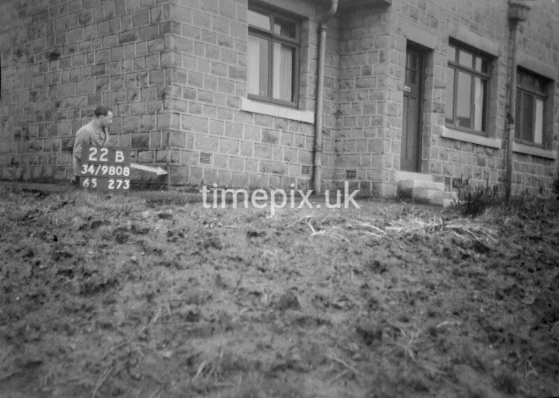 SD980822B, Man marking Ordnance Survey minor control revision point with an arrow in 1950s