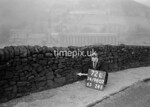 SD980772L, Man marking Ordnance Survey minor control revision point with an arrow in 1950s