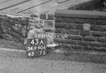 SD990643A, Man marking Ordnance Survey minor control revision point with an arrow in 1950s
