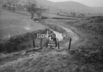 SD990813A, Man marking Ordnance Survey minor control revision point with an arrow in 1950s