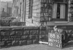 SD990588B, Man marking Ordnance Survey minor control revision point with an arrow in 1950s