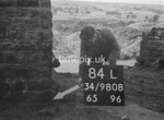 SD980884L, Man marking Ordnance Survey minor control revision point with an arrow in 1950s