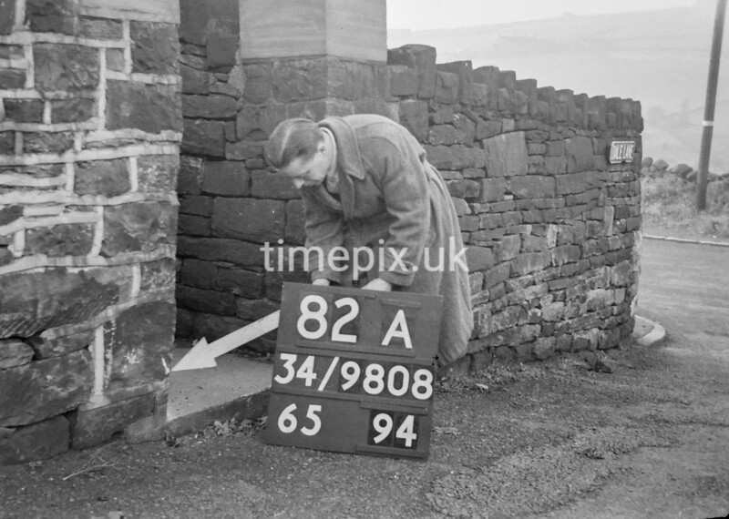 SD980882A, Man marking Ordnance Survey minor control revision point with an arrow in 1950s