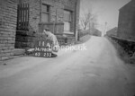 SD980811A, Man marking Ordnance Survey minor control revision point with an arrow in 1950s