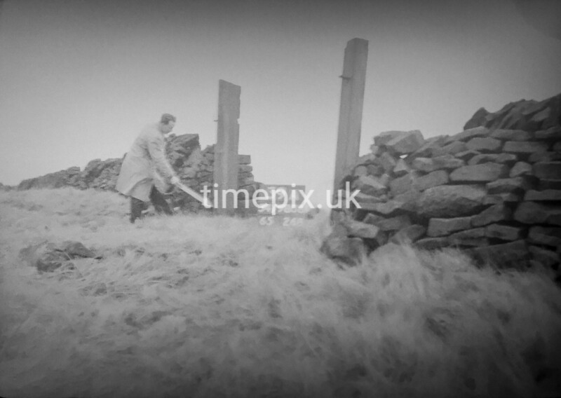 SD980839A, Man marking Ordnance Survey minor control revision point with an arrow in 1950s