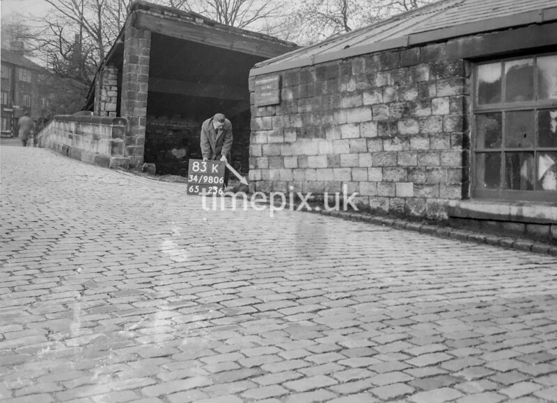 SD980683K, Man marking Ordnance Survey minor control revision point with an arrow in 1950s
