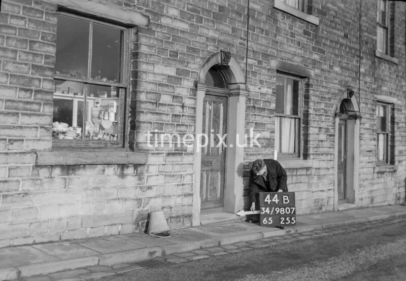 SD980744B, Man marking Ordnance Survey minor control revision point with an arrow in 1950s