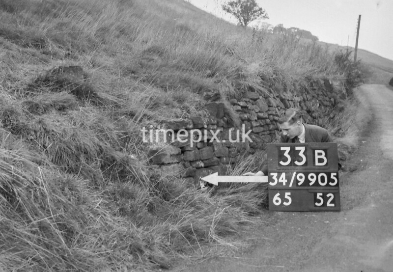 SD990533B, Man marking Ordnance Survey minor control revision point with an arrow in 1950s