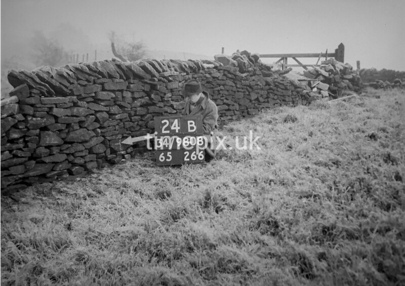 SD980824B, Man marking Ordnance Survey minor control revision point with an arrow in 1950s