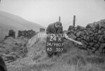 SD980724K, Man marking Ordnance Survey minor control revision point with an arrow in 1950s