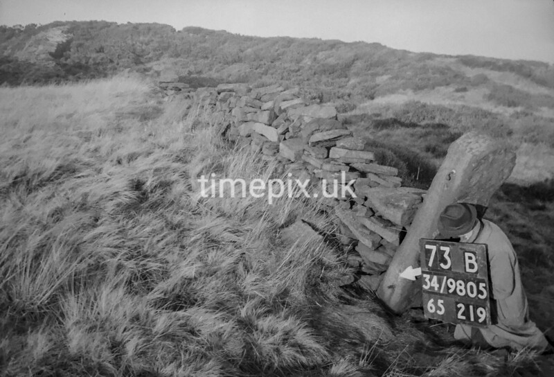 SD980573B1, Man marking Ordnance Survey minor control revision point with an arrow in 1950s