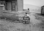 SD980820R, Man marking Ordnance Survey minor control revision point with an arrow in 1950s