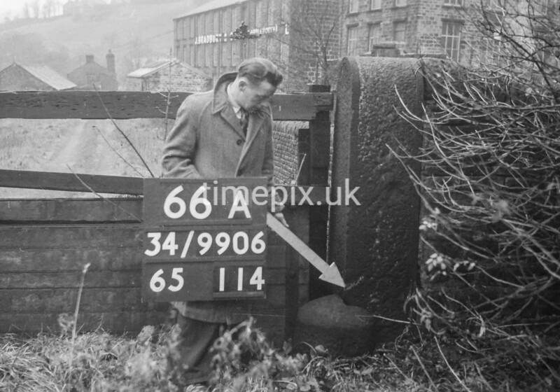 SD990666A1, Man marking Ordnance Survey minor control revision point with an arrow in 1950s