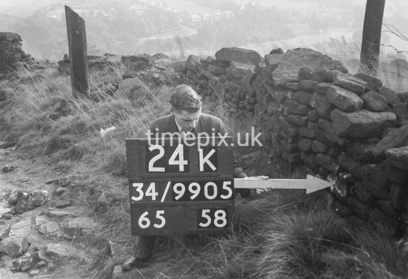 SD990524K, Man marking Ordnance Survey minor control revision point with an arrow in 1950s