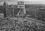 SD990694B, Man marking Ordnance Survey minor control revision point with an arrow in 1950s