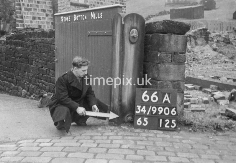 SD990666A3, Man marking Ordnance Survey minor control revision point with an arrow in 1950s