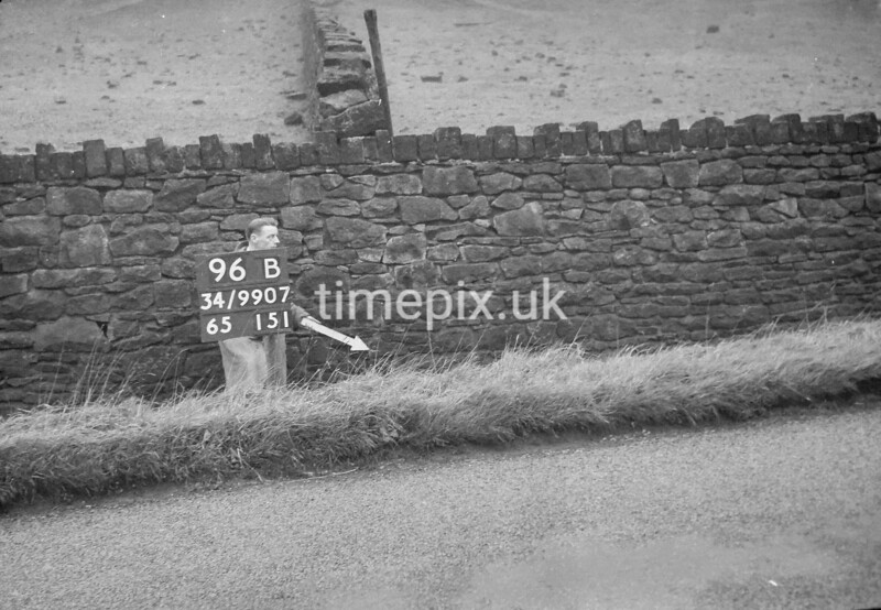 SD990796B, Man marking Ordnance Survey minor control revision point with an arrow in 1950s
