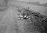 SD980868A, Man marking Ordnance Survey minor control revision point with an arrow in 1950s