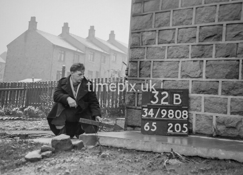 SD980832B, Man marking Ordnance Survey minor control revision point with an arrow in 1950s
