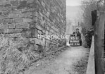 SD990795B, Man marking Ordnance Survey minor control revision point with an arrow in 1950s