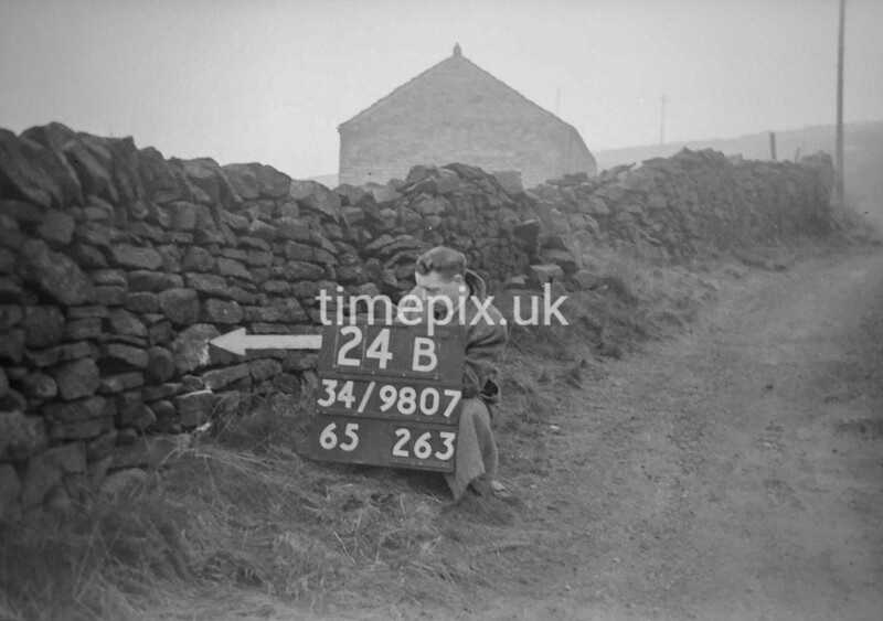 SD980724B, Man marking Ordnance Survey minor control revision point with an arrow in 1950s