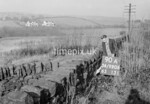 SD990690A, Man marking Ordnance Survey minor control revision point with an arrow in 1950s