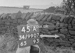 SD990745A, Man marking Ordnance Survey minor control revision point with an arrow in 1950s