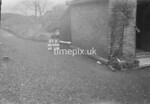 SD990651K, Man marking Ordnance Survey minor control revision point with an arrow in 1950s
