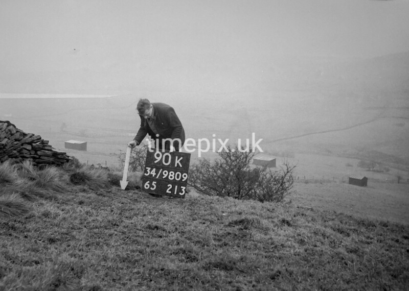 SD980990K, Man marking Ordnance Survey minor control revision point with an arrow in 1950s