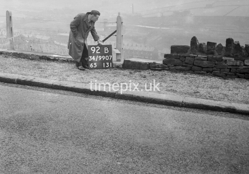 SD990792B, Man marking Ordnance Survey minor control revision point with an arrow in 1950s