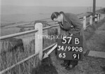 SD990857B, Man marking Ordnance Survey minor control revision point with an arrow in 1950s