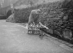 SD980692S, Man marking Ordnance Survey minor control revision point with an arrow in 1950s