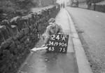 SD990624A, Man marking Ordnance Survey minor control revision point with an arrow in 1950s