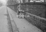SD990781B, Man marking Ordnance Survey minor control revision point with an arrow in 1950s