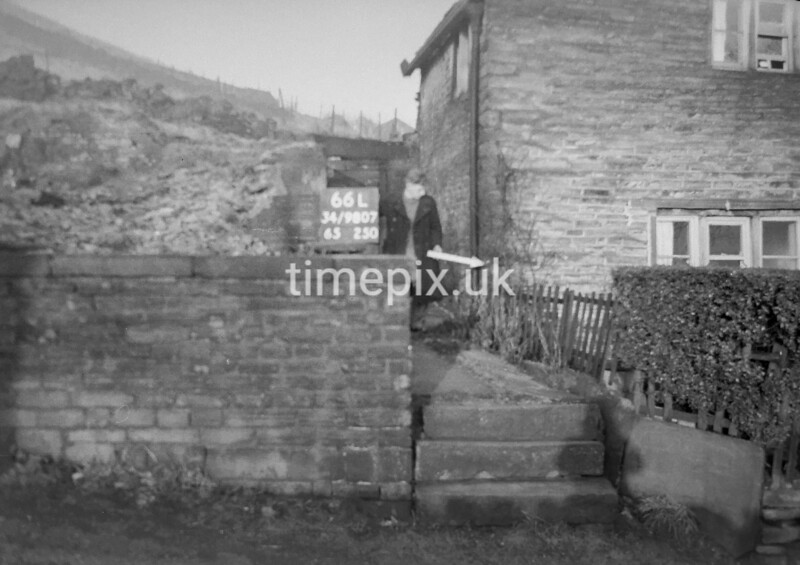 SD980766L, Man marking Ordnance Survey minor control revision point with an arrow in 1950s
