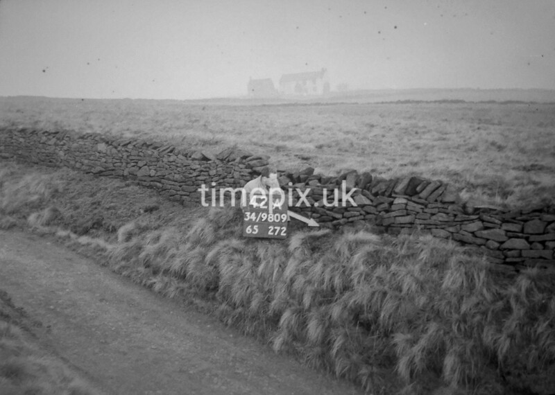 SD980942A, Man marking Ordnance Survey minor control revision point with an arrow in 1950s