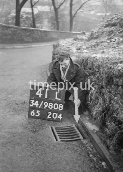 SD980841L, Man marking Ordnance Survey minor control revision point with an arrow in 1950s