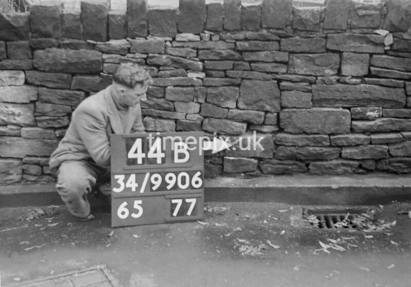 SD990644B, Man marking Ordnance Survey minor control revision point with an arrow in 1950s