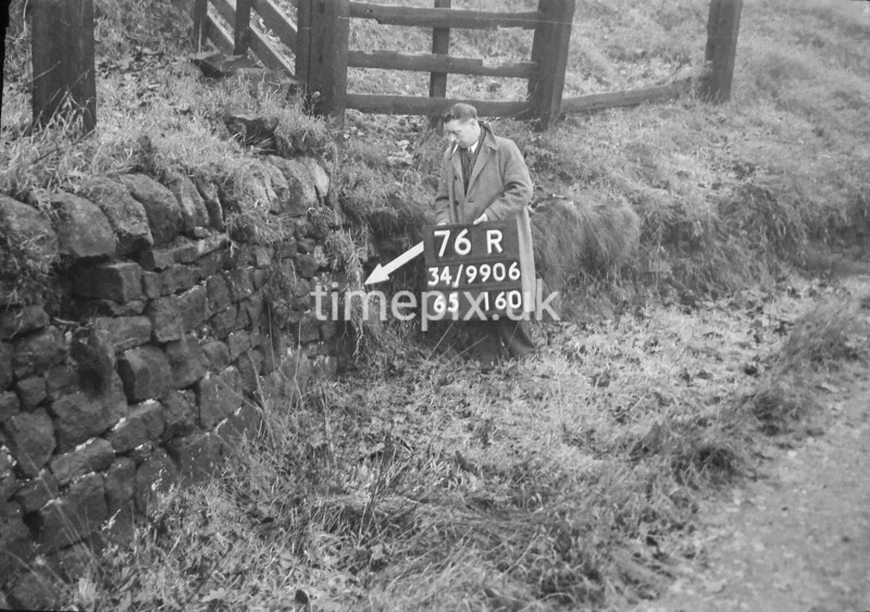 SD990676R, Man marking Ordnance Survey minor control revision point with an arrow in 1950s